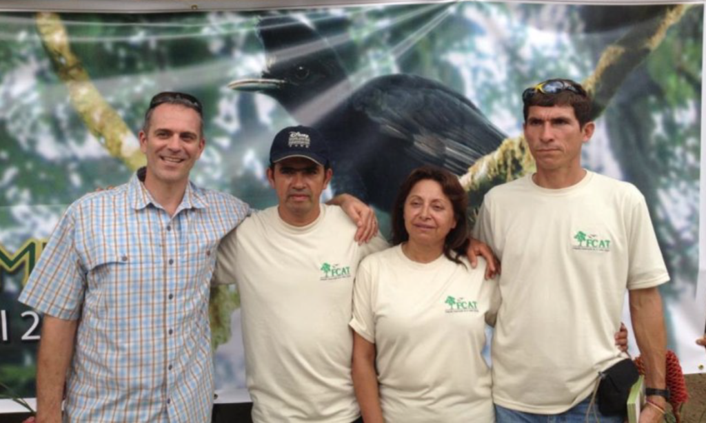 From left to right:  Jordan Karubian, Jorge Olivo, Monica Gonzalez and Domingo Cabrera at an Environmental Fair put on by FCAT, to recognize and celebrate local community conservation of the Long-wattled Umbrellabird.
